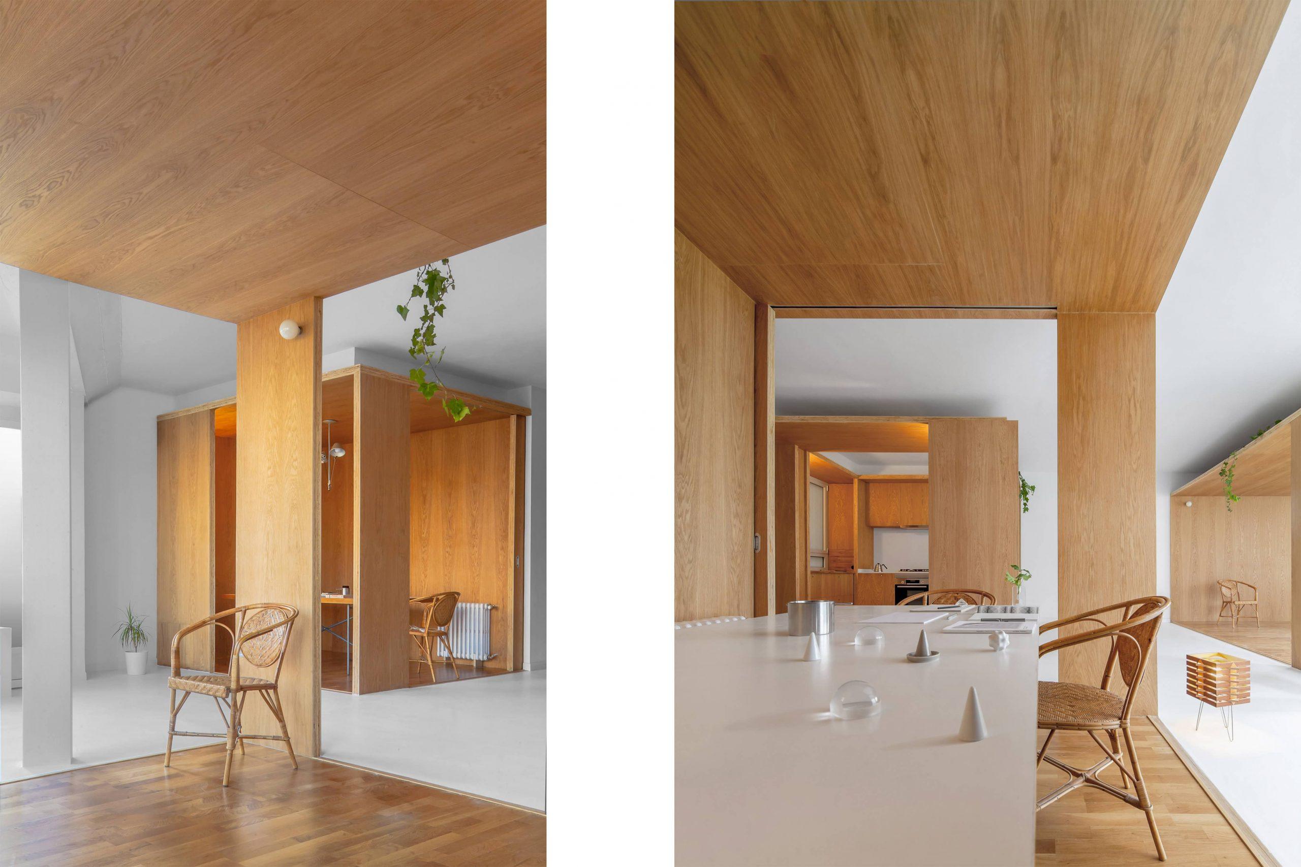 Sala de estar y estudio de la rehabilitación arquitectónica del apartamento extenso-intenso en Barcelona